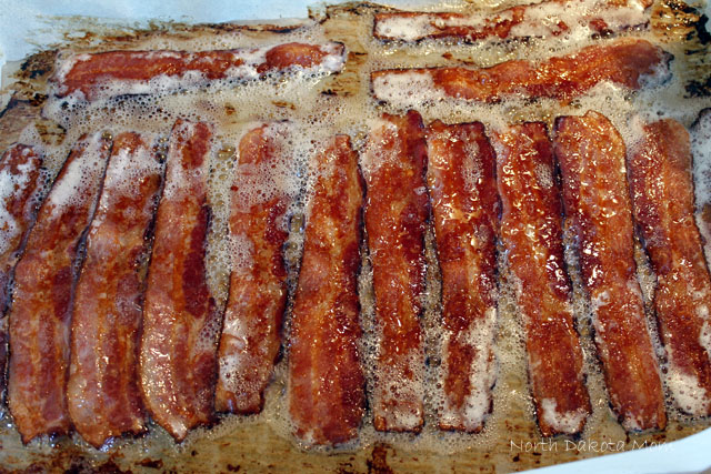 I like to cook my bacon in the oven. No worrying about flipping and no splattering mess.